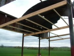 Cross beams and the new roof supports being fitted